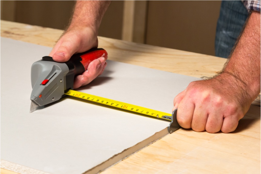 Use the measuring tape as a guide for cutting